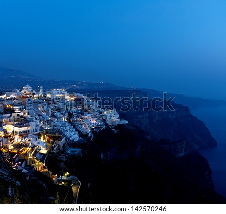 Nigth view of Fira,the village perched in the volcanic cliff.Santorini island.Greece. - stock photo