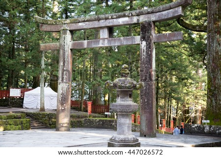 NIKKO, JAPAN - APRIL 14 : The Torii gate at entrance of Nikko Toshogu Shrine, Nikko, Japan on April 14, 2016. The world Heritage are famous for tourist around the world.
