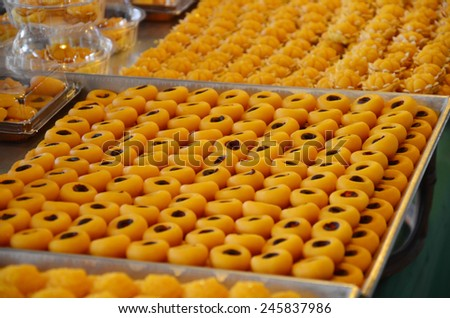 Nine auspicious Thai desserts name SA NEH JAAN - is made of rice flour, Coconut milk and egg yolk. It looks like nutmeg. It means loved from other people. - stock photo