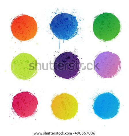 Nine bright grunge circles with splashes on white background.