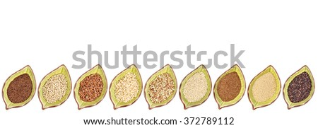nine gluten free grains (black quinoa, buckwheat, amaranth, teff, sorghum, kaniwa, millet, and brown rice) - a row of leaf shaped ceramic bowls isolated on white with a copy space - stock photo