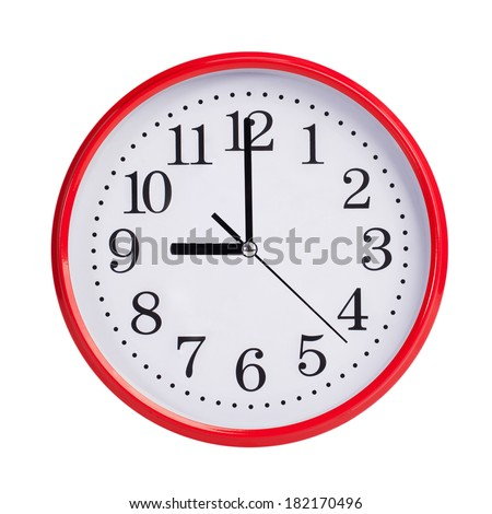Nine o'clock on a red round dial - stock photo