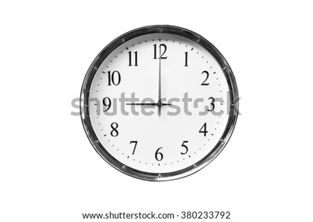 Nine o'clock on the white wall clocks (isolated) - stock photo