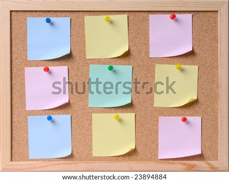 nine papers attached to a corkboard.