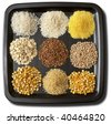 Nine sorts of cereals on the black plate macro shot background - stock photo