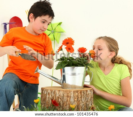 Nine Year Old Boy and Girl Working Together in Garden Over White Background - stock photo