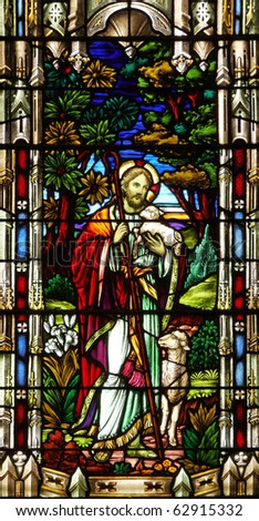 Nineteenth century church stained glass window Jesus shepherd - stock photo