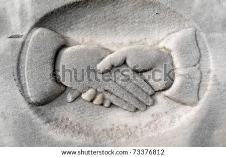 Nineteenth century gravestone detail hands clasping - stock photo