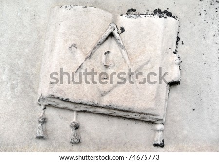 Nineteenth century gravestone detail Masonic symbol and tasseled book - stock photo