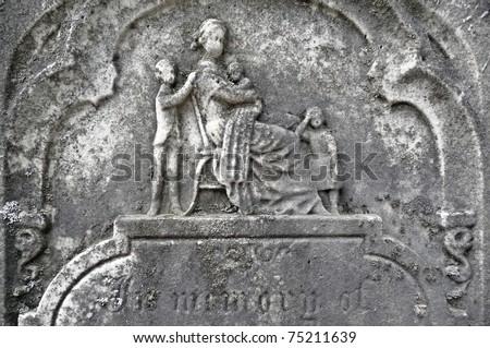 Nineteenth century gravestone fatherless family left behind - stock photo