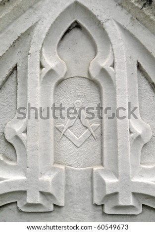 Nineteenth century ornate gravestone detail masonic symbol - stock photo