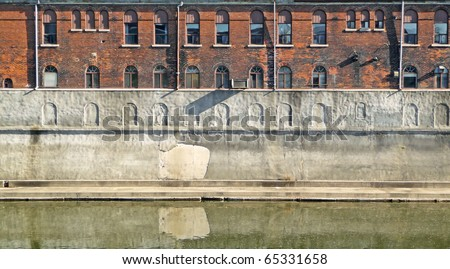 Nineteenth century river side building atop levee - stock photo