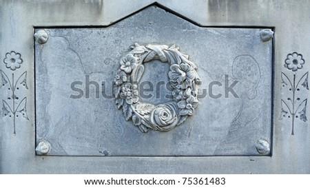 Nineteenth century white bronze gravestone wreath and flowers - stock photo