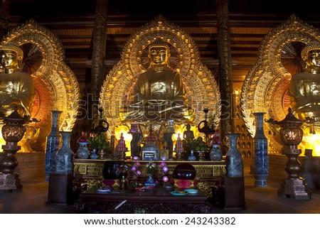 NINH BINH, VIETNAM - AUG 2, 2012: Golden Buddha images in Bai Dinh temple near Ninh Binh, Vietnam - stock photo