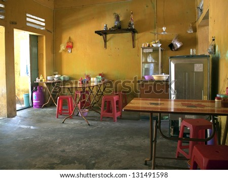 NINH BINH, VIETNAM - AUG 1: Interior of local cheap restaurant on Aug 1, 2012 in Ninh Binh, Vietnam. Such simple place can have just one meal - for example Pho Bo.