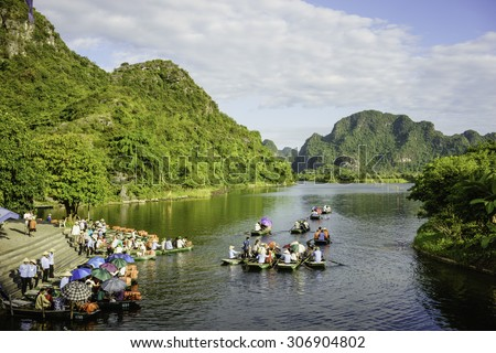 NINH BINH, VIETNAM, JUNE, 28: Unidentified tourists in Trang An on JUNE, 28, 2015. Trang An is the scenic area, ranked special of Vietnam.