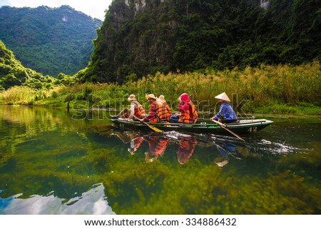 Ninh Binh, Vietnam Otc 29,2015: Tourist in Trang An- Tam Coc, Vetnam. Trang An is UNESCO World Heritage Site, renowned for its boat cave tours. It's Halong Bay on land of Vietnam