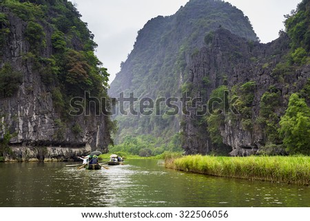 "NINHBINH, VIETNAM - May 17, 2015: Unidentified people tourist at ""Ngo Dong"" river in Tam Coc Bich Dong heritage, Ninh Binh province, Vietnam."