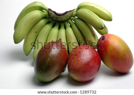 nino bananas and mangoes - stock photo