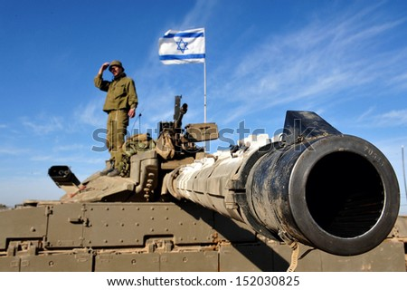 NIR OZ, ISRAEL - JAN 13: Merkava Tank on JAN 13 2009. The Mark IV has the Israeli-designed TSAWS system, It designed to endure the harsh basalt rock conditions of Golan Heights with minimal track-shedding