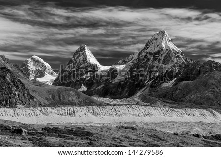 Nirekha (6169 m), Kangchung (6062 m), and Chola (6069 m) in the area of Cho Oyu - Gokyo, Nepal, Himalayas (black and white) - stock photo