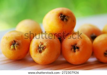 nispero, Japanese medlar fruit, on table - stock photo