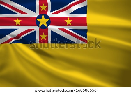 Niue flag blowing in the wind. Background texture.