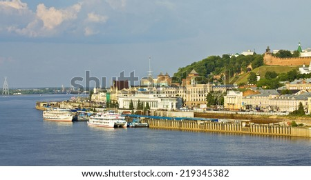 NIZHNIY NOVGOROD, RUSSIA - JUNE 03, 2013: river port on Volga, has been built in 1967, and middle ages fortress Kremlin of 16 century. - stock photo