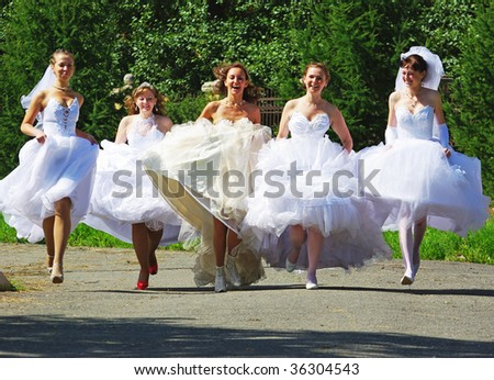 NIZHNIY TAGIL, RUSSIA - AUGUST 09: group of happy excited brides running at Parade of Brides August 09, 2009 in Nizhniy Tagil