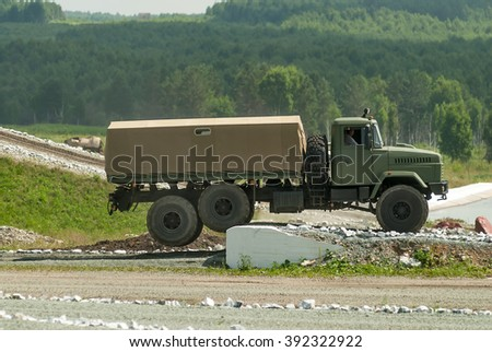 Nizhniy Tagil, Russia - July 12. 2008: Curtain sided KRAZ truck comes around on high obstacle. Display of opportunities of arms and military equipment. RAE exhibition.
