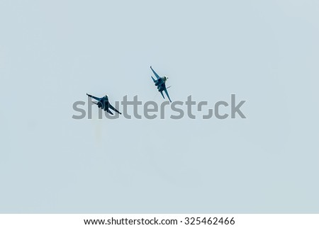 Nizhniy Tagil, Russia - July 12. 2008: Russian fighters SU-27 knight put bend. Display of fighting opportunities of equipment with application of aviation means of defeat. RAE exhibition - stock photo