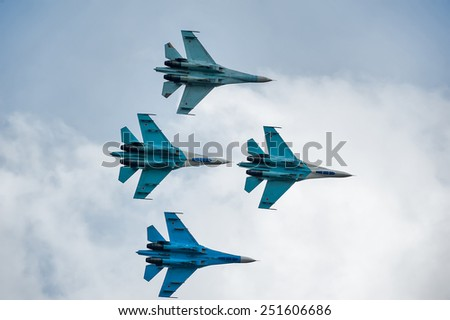 "Nizhniy Tagil, Russia - September 25. 2013: Demonstration performances of flight group ""Falcons of Russia"" on Su-27. RAE-2013 exhibition (Russia Arms Expo-2013) - stock photo"