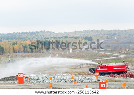 Nizhniy Tagil, Russia - September 25. 2013: Direct fire suppression vehicle MPT-521 in action. Display of opportunities of equipment. Russia Arms Expo-2013 exhibition - stock photo