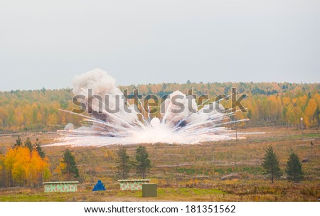 Nizhniy Tagil, Russia - September 25. 2013: Display of fighting opportunities of arms and military equipment of land forces. Thermite bomb explosion. RAE-2013 exhibition - stock photo