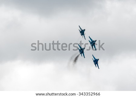 Nizhniy Tagil, Russia - September 25. 2013: fighters SU-27 display of fighting opportunities of equipment with application of aviation means of defeat. RAE-2013 exhibition. Russia Arms Expo-2013 - stock photo
