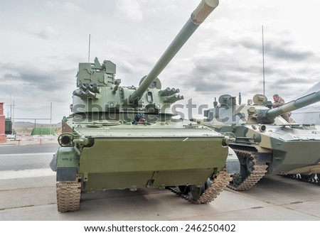 Nizhniy Tagil, Russia - September 25 2013: Visitors examine military equipment on exhibition range. Airborne tracked armoured personnel carrier BMD-4M with additional protection - stock photo