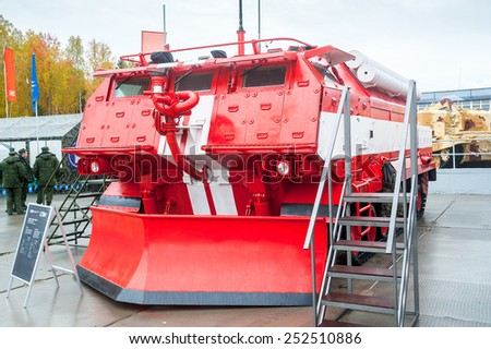 Nizhniy Tagil, Russia - September 25. 2013: Visitors explore military and special equipment on exhibition range. Special fire fighting vehicle SPM. Russia Arms Expo-2013 exhibition - stock photo