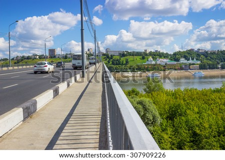 NIZHNY NOVGOROD, RUSSIA - AUG 12, 2015: Kanavinsky bridge on the river Oka is for cars and pedestrians. It is the oldest bridge in the city of Nizhny Novgorod - stock photo