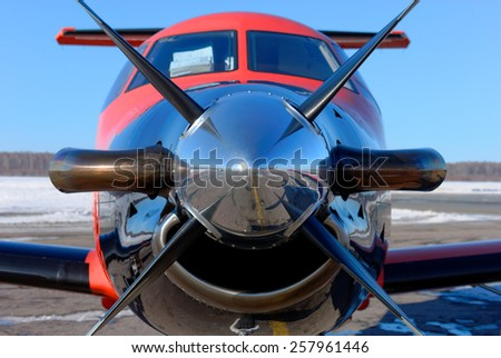 NIZHNY NOVGOROD. RUSSIA. FEBRUARY 17, 2015. Cabin of the pilot and propeller of the Pilatus light airplane of the Dexter company - stock photo