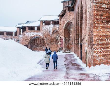 Nizhny Novgorod, Russia - January 03: People walking along the Kremlin in Nizhny Novgorod, Russia on January 03, 2015. The Kremlin is a fortress in Nizhny Novgorod, the historic city center. - stock photo