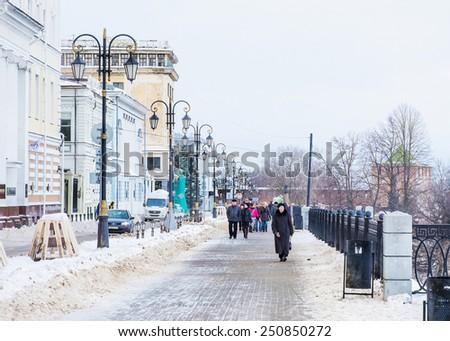 Nizhny Novgorod, Russia - January 03: people walking along the Oka riverside in Nizhny Novgorod, Russia on January 03, 2015.  - stock photo