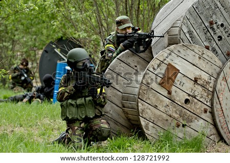 NIZHNY NOVGOROD, RUSSIA - MAY 13: Airsoft player fighting on may 13, 2012 in shooting ground near Nizhny Novrogorod, Russia. Airsoft is a recreational activity with replica firearms.