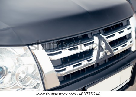 Nizhny Novgorod, Russia - September 14, 2016: The black bonnet, radiator grille a sign logo of the Mitsubishi Pajero Sport Car