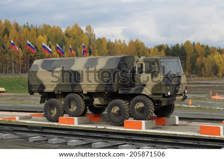 NIZHNY TAGIL, RUSSIA - SEP 26, 2013: The exhibition RUSSIA ARMS EXPO (RAE-2013). The Ural-5323 is a 8x8 heavy-duty off-road truck specially designed for army service
