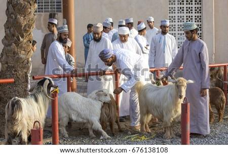 Fantastic Oman Eid Al-Fitr 2018 - stock-photo-nizwa-oman-june-rd-omani-people-at-a-habta-market-before-eid-al-fitr-676138108  Pic_272640 .jpg