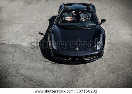 NJ - Car Show - April 2015 - Ferrari 458 Spider sitting in parking lot - stock photo
