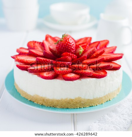 no baked strawberry cheesecake on white background, selective focus, square image - stock photo