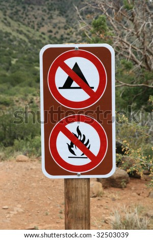 no camping no fires no campfires sign along a trail in Arizona