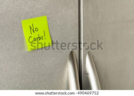 No carbs reminder sticky note on a home refrigerator.