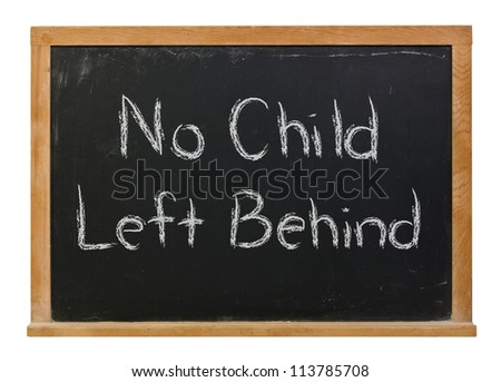 No Child Left Behind written in white chalk on a black chalkboard